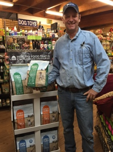 Bobby, a 9 year veteran of our Feed Department shows off the Open Farm display.